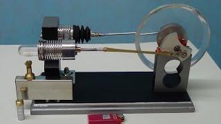 Motor Stirling Gama fabricação caseira, usando fole de borracha como cilindro de força, com sistema de ajuste independente do  curso de cada pistão.Baixo nível de ruido, pistão deslocador em alumínio volante de acrílico.Ipatinga - MG - Brasil