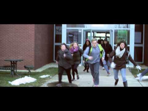 People running out of a school.