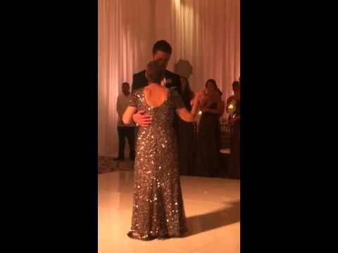 Mother in her final days before losing battle with cancer has one last dance with her son at his wedding.