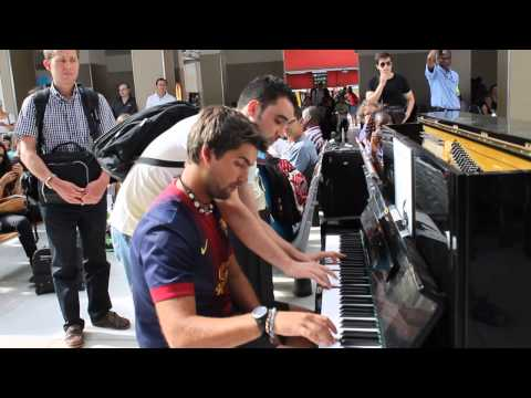 Two Strangers Play The Piano Together At Paris Train