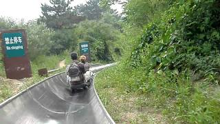 On the luge slide at MuTuanYu Great Wall