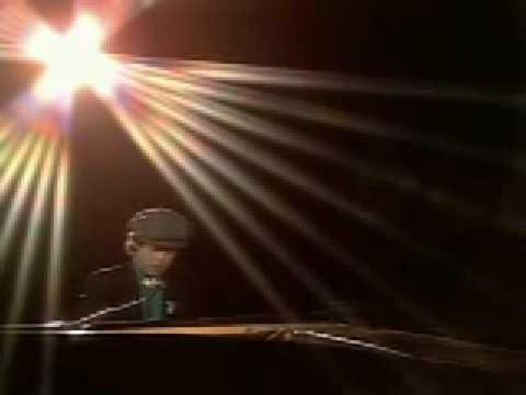 Tekst piosenki Elton John - Georgia po polsku