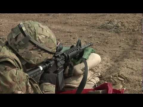 m4 - An NCO and his soldier at a range at a remote outpost in Afghanistan. Shots include close-ups of rounds discharging, rounds leaving the weapon, and the NCO g...