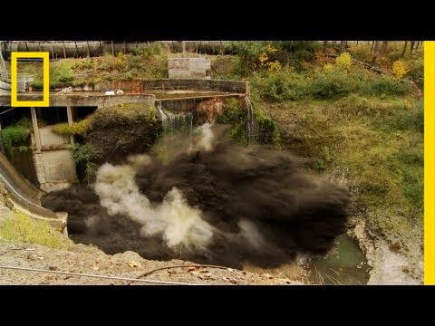 spectacular - October 28, 2011 — The White Salmon River in Washington state is flowing again as the nearly 100-year-old Condit Dam was disabled with explosives Wednesday. ...