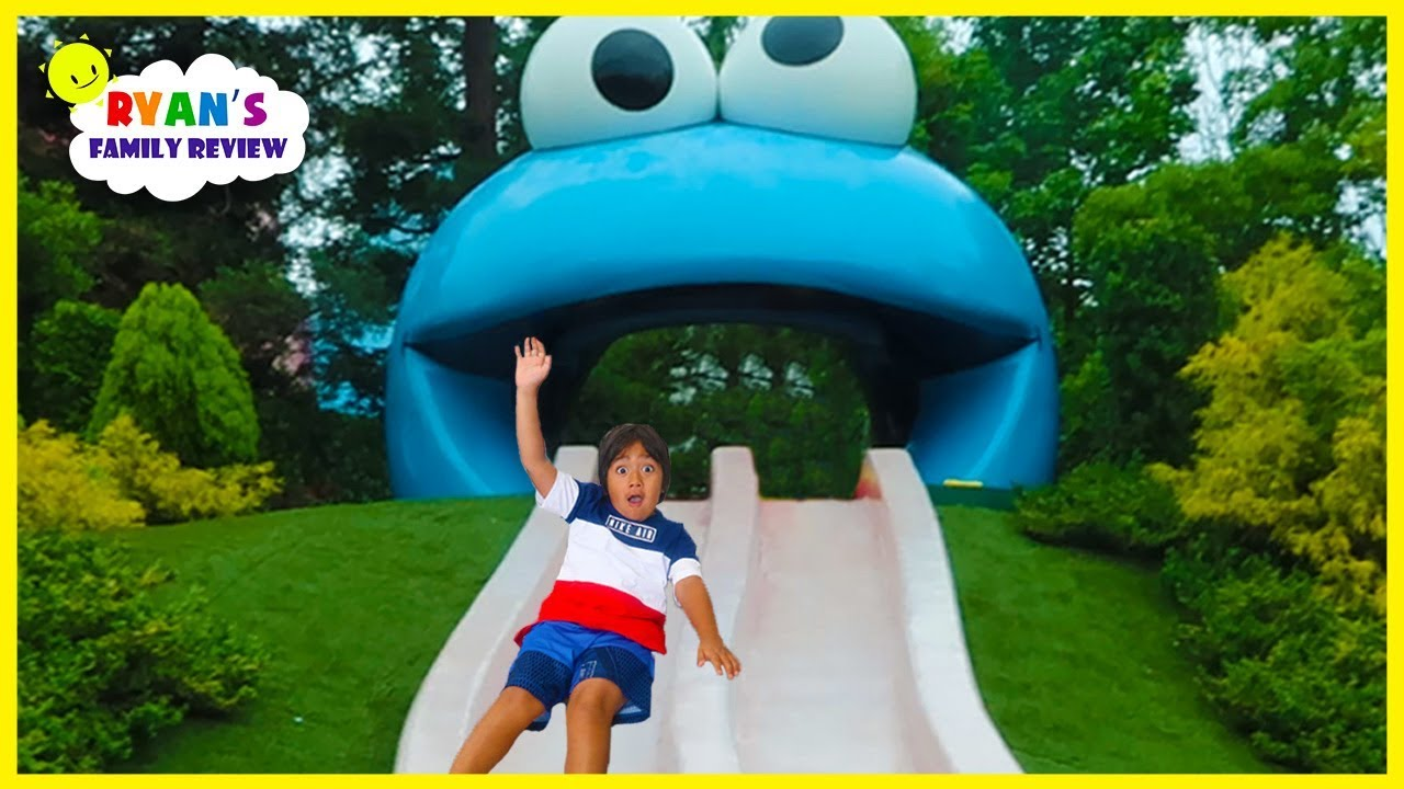 Ryan meets Cookie Monster and Ride Jurassic World Roller Coaster at Universal Studios - YouTube