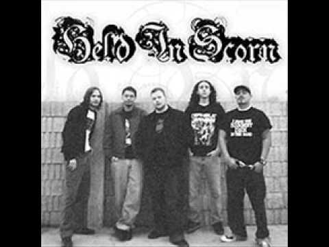 Held In Scorn - The Lowering Storm
