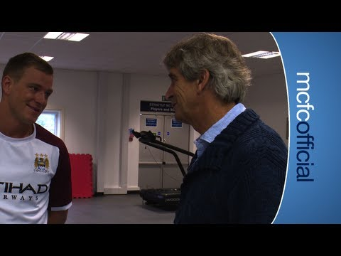 mcfcofficial - An Inside City special of Manuel Pellegrini's arrival in Manchester. The Chilean tours Carrington and The Etihad Stadium meeting players and staff. 00:14 - P...