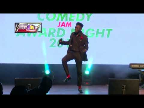 Kenny Blaq on stage at naija comedy jam(Mans not Hot)