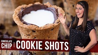 """Drink your milk and cookies straight from a Chocolate Chip Cookie Shot glass! This fun dessert makes for a great party food. So much fun! ________________________________________↓↓↓↓↓↓ CLICK FOR RECIPE ↓↓↓↓↓↓↓↓ _______________________________________How to make Chocolate Chip Cookie ShotsPOPOVER PAN: http://amzn.to/2trMCHOSHOT MOLDS: http://amzn.to/2uvLO9QINGREDIENTS1 cup all vegetable shortening1/2 cup brown sugar1/3 cup sugar1 egg2 tsp vanilla extract1/2 tsp salt2 cups flour2 cups semi-sweet mini chocolate chips, dividedINSTRUCTIONS1. Preheat oven to 350 degrees. Lightly grease a nonstick popover pan.2. In a large mixing bowl, use a hand mixer to beat together shortening, brown sugar, and sugar until mixture is fluffy.3. Add in the egg, vanilla extract, and salt and mix until smooth.4. Use a large spoon to stir in flour. Mixture will be really crumbly, but should hold together when pressed. Stir in 1 cup mini chocolate chips until combined.5. Scoop mixture into popover pan and press to the bottom and sides, making sure to leave a hole in the middle for the milk to go later. You only need the sides and bottom to be about 1/4 inch thick. It's hard to get it much thinner.6. Bake in the preheated oven for 18-20 minutes until cookies get a golden brown kiss.7. Carefully remove the cookies from the popover pan. This can be done by placing a large cutting board or pan over the popover sheet and flipping it over. Gently tap the bottoms of the popover cups to loosen. Let cool completely.8. Carefully melt the remaining 1 cup of chocolate chips in a microwave safe bowl by microwaving for 15 seconds at a time, removing and stirring, until chocolate is melted.9. Coat the holes in the cookie cups with the chocolate. Drizzle some in and swirl, or if your chocolate is on the thicker side just give it a good smearing.10. Refrigerate until chocolate is set. Serve by filling the """"cups"""" with milk and enjoy!Thanks for watching! Don't forget to push """"LIKE,"""" leave a COMMENT below, and S"""