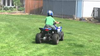6. 4 Year Old Riding Polaris Outlaw 50 ATV