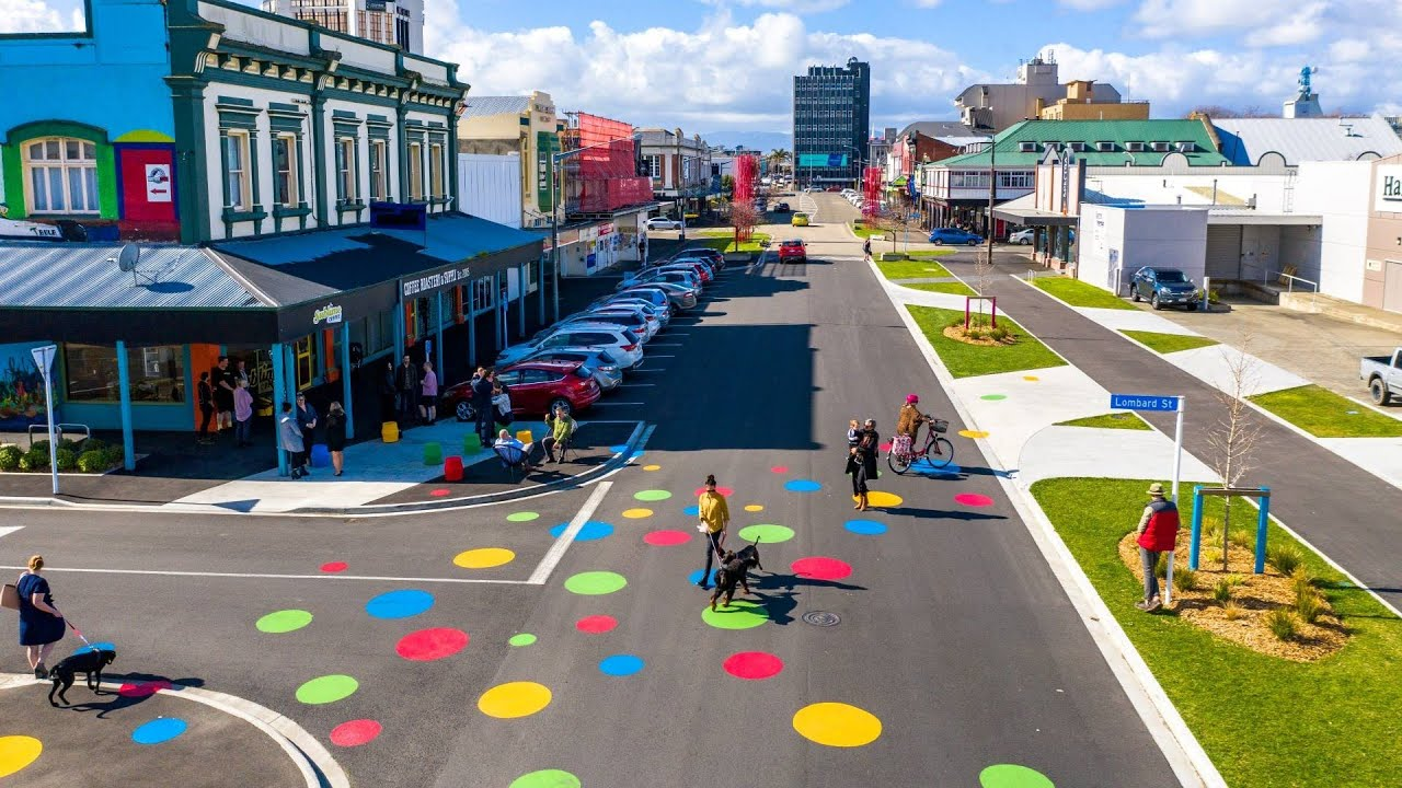 YouTube placeholder image shows people walking, biking, scooting and sitting on the newly revamped Cuba Street.