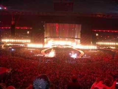U2 - Tryin' To Throw Your Arms Around The World lyrics