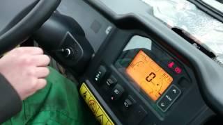 10. John Deere Gator XUV825i starting inside the cab