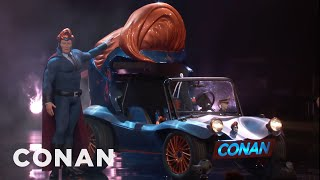#ConanCon Highlight: Conan worked with West Coast Customs to design a vehicle fit for his superhero alter ego.More CONAN @ http://teamcoco.com/videoTeam Coco is the official YouTube channel of late night host Conan O'Brien, CONAN on TBS & TeamCoco.com. Subscribe now to be updated on the latest videos: http://bit.ly/W5wt5DFor Full Episodes of CONAN on TBS, visit http://teamcoco.com/videoGet Social With Team Coco:On Facebook: https://www.facebook.com/TeamCocoOn Google+: https://plus.google.com/+TeamCoco/On Twitter: http://twitter.com/TeamCocoOn Tumblr: http://teamcoco.tumblr.comOn YouTube: http://youtube.com/teamcocoFollow Conan O'Brien on Twitter: http://twitter.com/ConanOBrien