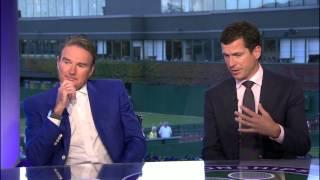 Roger Federer walking across bridge at Wimbledon with Myla and Charlene.