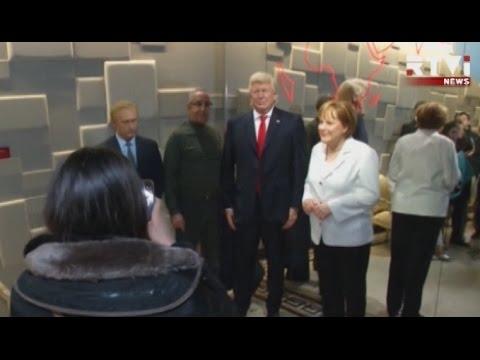 Трамп встретился в Париже с Путиным и Меркель, правда восковыми (видео)