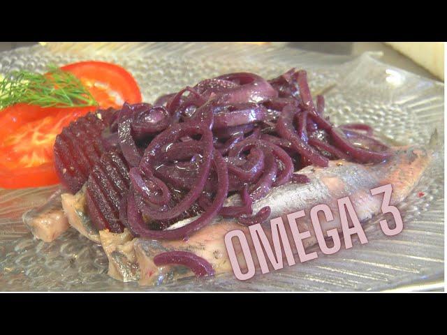 Holländischer Matjes an roter Bete und in Portwein marinierten Zwiebeln