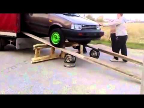 Ramp collapses as car its loaded into truck