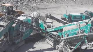 Powerscreen 5 machine train including mobile cone crushers, jaw crushers and screens processing Graywacke Sandstone