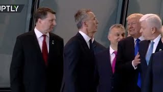 US President Donald Trump was caught on camera pushing Montenegrin Prime Minister Dusko Markovic out of the way at the NATO summit in Brussels.