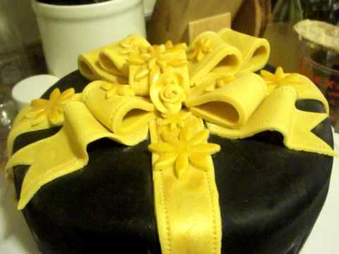 fondant suitcase cake - Gold Ribbon Fondant Cake (My first Fondant Cake) I used Satin Ice fondant for black fondant (its tastier). For the ribbon, I used the Wilton white fondant an...