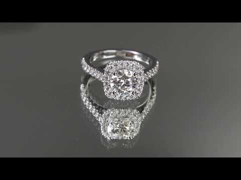 Halo style 1 carat diamond engagement ring