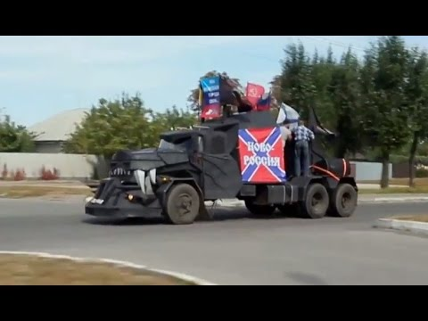 raw - A group of rebels on Sunday, led a convoy of their vehicles through Lugansk, which has been hit hard by the recent conflict in eastern Ukraine. RT LIVE http://rt.com/on-air Subscribe to...