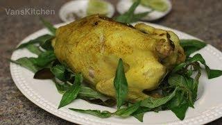 Gà hấp muối (Steamed chicken on a bed of rock salt)