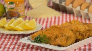 Polvilhe os bifes de frango de ambos os lados com o Knorr® Granulado de Galinha.
