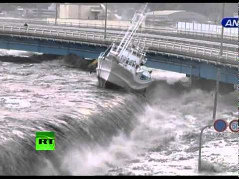 Japan: Tsunami Spills Over Seawall