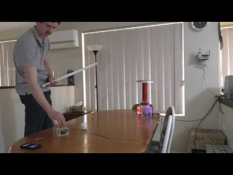 This happens when you touch a Tesla Coil at 250,000 V (видео)