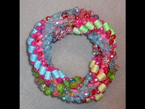 tsummerlee - Chunky triple spiral stitch was done with large plastic beads in a variety of sizes, colors and shapes. Core beads are 8mm plastic pony beads. I used 8lb Fir...
