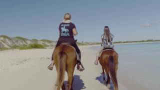 Tonya Richardson, a UK native who runs Seaside Stables, says that belonging is a lifestyle. Watch her lead visitors into the clear...