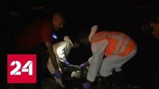 Мигранты чудом выжили во время крушения лодок у берегов Ливии. Видео