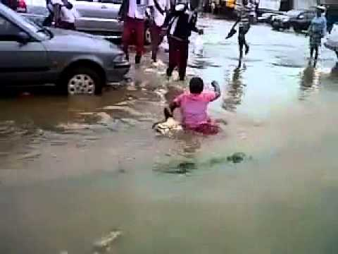 drowned woman - The city of Accra came to standstill after hours of heavy downpour. Luck ran out for this poor woman who nearly got washed away in the flood whilst crossing ...