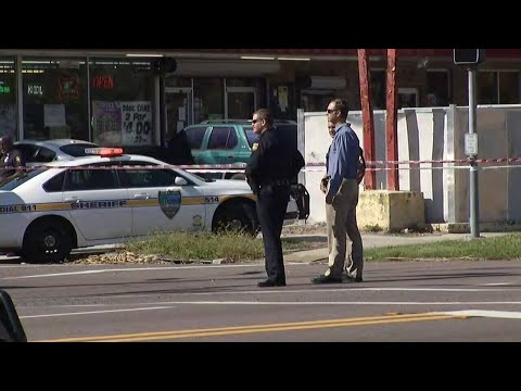 Woman shot after fight breaks out
