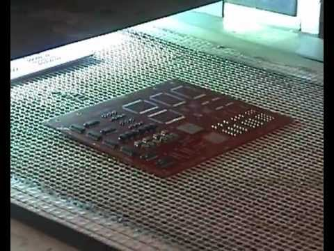 UV conformal coating - Conformal Coating ultraviolet UV cure processing on a conveyor belt.