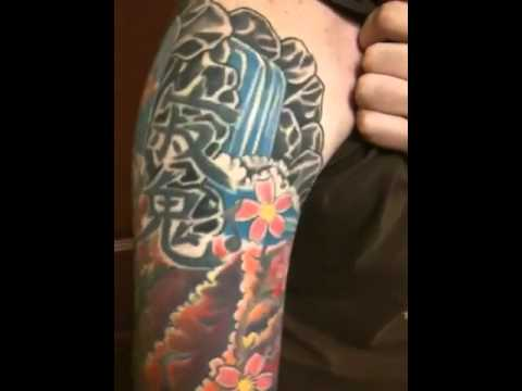 colorful asian style sleeve tattoo done by brandon mull