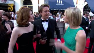 Stars of Broadchurch Jodie Whittaker & Andrew Buchan meet Jenni Falconer on the red carpet at the Arqiva British Academy Television Awards in 2014.