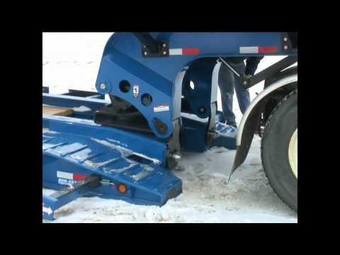 John Deere Combine Loading onto a Big Tow Low Boy Trailer