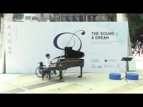 "This is Tang Cheuk Him's artwork - Tang Cheuk Him at ""The Sound of a Dream"", Artist with Disability Development Scheme – Community Inclusion Event 2015 Poulenc – Novelette No.1 in C Major"