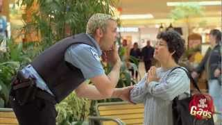 Policeman Cleans Victims' Faces Gag