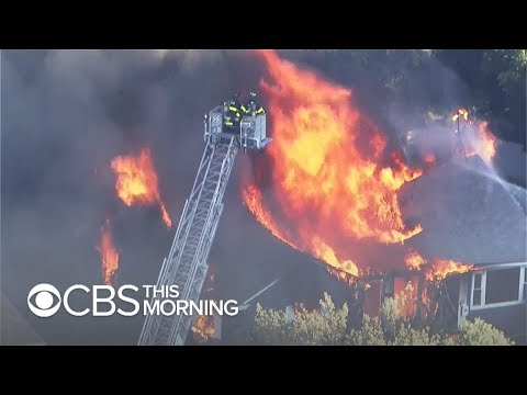 Flames from gas explosions engulf 60+ structures in 3 Mass. towns