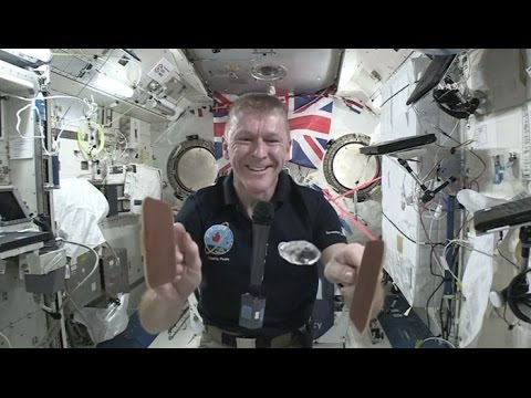 British astronaut Tim Peake plays ping pong in space to teach school children how liquids behave in space.