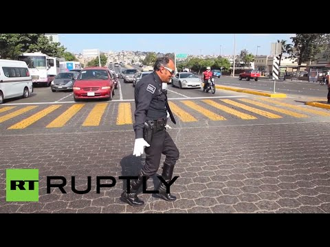 Taking - Police officer Jose Ruben Echeverria showed he had the moves Sunday in the Mexican city of Tijuana, dancing to some of Michael Jackson's greatest hits while directing traffic. Numerous bystanders...