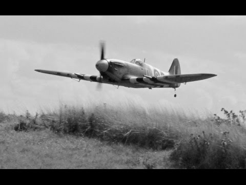 YT - A COMPILATION OF FOUR FLIGHTS DEANO & I HAD WITH OUR ESM / YT INTERNATIONAL MK X1V SPITFIRE DOWN THE PATCH, SHES POWERED BY A DLE 35cc RA (REAR EXHAUST) PETR...