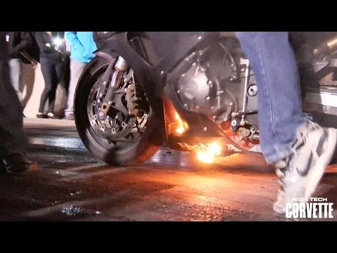 Motorcycle erupts in flames doing a burnout