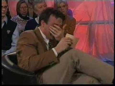 laughing - Dutch TV presenter can't stop laughing. Or could he be Belgian :)