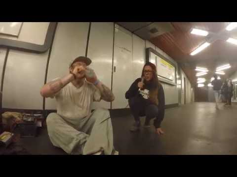 Girl joins rapper in the subway for an impromptu jam session