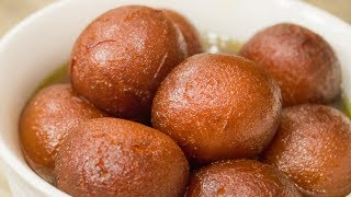 Gulab Jamuns or Gulab Jamoon is one of the most eaten Indian Sweets, this popular milk based sweet is usually made with khoya/mawa, cottage cheese and flour. Today, let's make a very easy, quick and instant recipe for Gulab Jamuns using Powdered Milk which is usually available in most of the Indian homes. You no longer need to wait for Diwali to come now :)Learn how to make more Indian Sweets : https://goo.gl/V72jO2Buy Milk Powder Online - http://amzn.to/2slcAwvSubscribe to #seesomethingnew: http://goo.gl/Pw8vy7 Follow CookingShooking on Instagram @Cooking.ShookingFollow Yaman on Instagram @yaman.agBusiness Emails - business@cookingshooking.comIngredients: Milk - 1/2 cup / 120ml Milk Powder - 1 1/2 cup / 150gGhee - 1/4 cup / 60gSugar - 3 cupsWater - 1 cupMilk - 2 tbspGulab Jal / Rose Water - 1/2 tspSaffron - few strandsMaida - 4 tbspCardamom Powder - 1/4 tspBaking Powder - 3/4 tspWater - 3 tbspGulab Jal - 1/2 tspGhee - to deep fry Method:Mawa Substitute : In a pan, add - milk, ghee and milk powder. Stir well before turning the flame on. Cook in medium flame until it forms a pat, approximately 4-5 mins.Once the consistency is like mawa, turn the flame off and transfer to a bowl.For Sugar Syrup : Add the sugar to a pan with 1 cup of water and boil until sugar is melted. If the sugar syrup is not clear, add 2 tbsp milk, stir once and let it boil 2-3 minutes.Skim the dirt off the surface using a perforated spoon. Add saffron, gulab jal and mix well, add more water as required to form a sticky consistency sugar syrup.Turn the flame off and keep aside.Forming Gulab Jamun:  To the cooled mawa substitute add - maida, cardamom powder, baking powder, gulab jal and 2 tbsp of water. Mix all ingredients and start kneading, add remaining 1 tbsp water if required to make a soft and smooth dough.Divide the mawa dough into 16 equal portions and smoothen then by pressing each between palm and slowly releasing pressure whilst rolling them to a smooth round ball.Keep all the dough cove